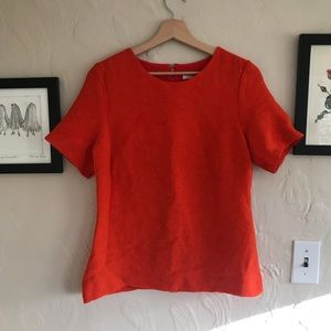 Orange lined shirt with great texture & open back